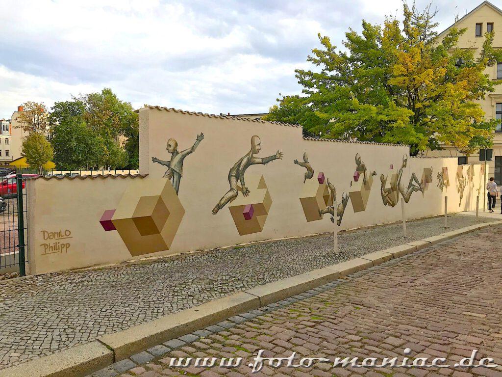 Schöne Graffiti in Halle - Figuren mit Würfeln auf einer Mauer