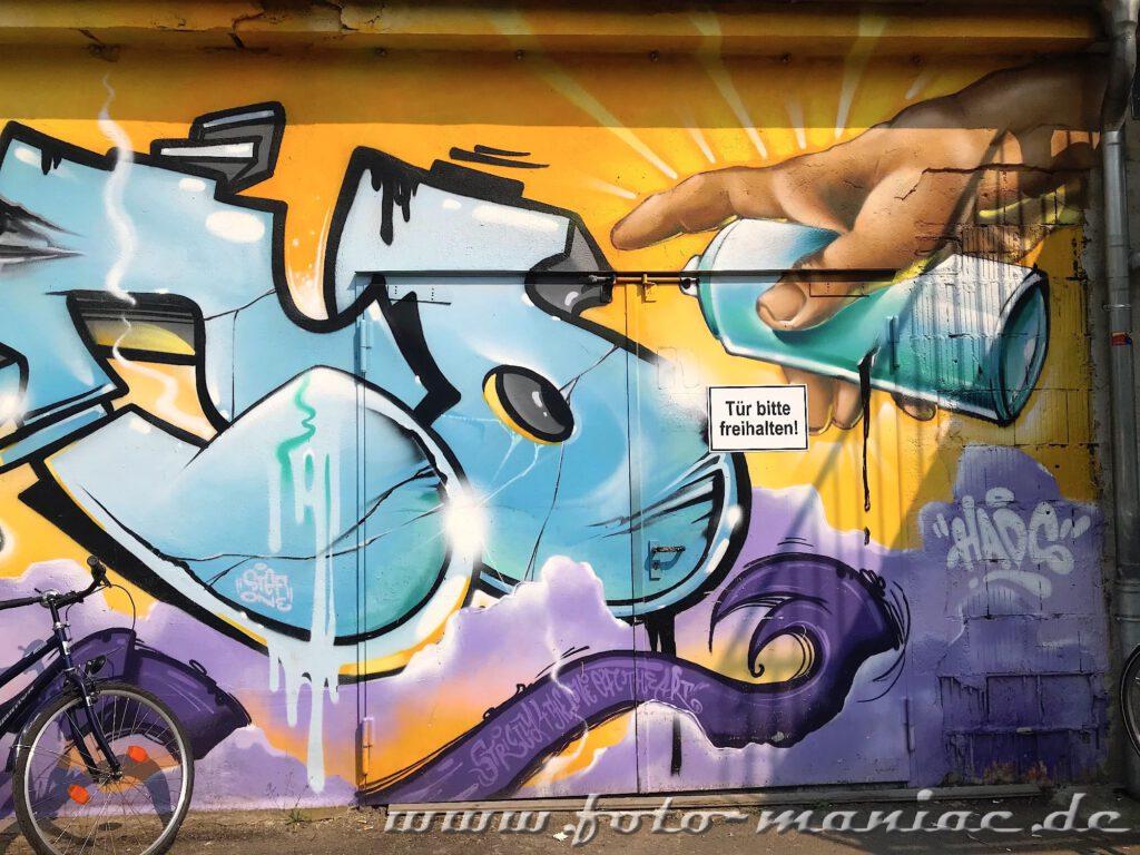 Spraydosen-Graffito auf einer Wand