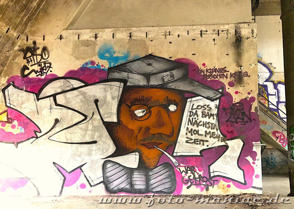 Männerporträt als Graffito an der Wand